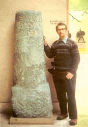 author beside Roman milestone in Rome
